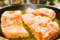 Frying fresh salmon Royalty Free Stock Images