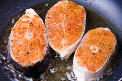 Frying fresh salmon on the pan. See my other works in portfolio Royalty Free Stock Photos