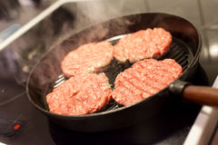 Frying Hamburgers Royalty Free Stock Images