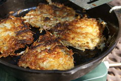 Frying Hash Browns Stock Photo