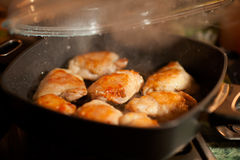 Frying hot chicken with smoke Stock Photography