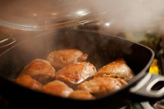 Frying hot chicken with smoke Royalty Free Stock Photography