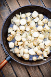 Frying jerusalem artichoke Stock Image