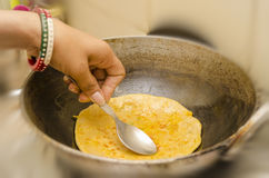 Frying karai prantha in refined oil Stock Photo