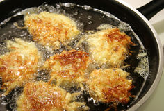 Frying Latkes For Hanukah Stock Images