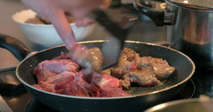 Frying meat on the pan stock footage