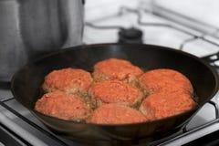 Frying  meat rissoles Stock Photo