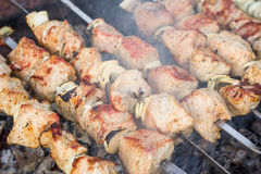 Frying meat on skewers Royalty Free Stock Photos