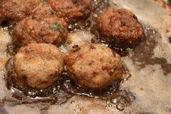 Frying meatballs Royalty Free Stock Photo