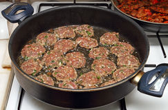 Frying meatballs Stock Images