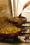 Frying meatballs and zucchini. In a cooking class in Squalzino, Puglia, Italy stock photo