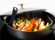 Frying meet and vegies in skillet steaming Stock Photos