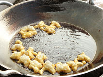 Frying mini Chinese Churros. Delicious Asia, Asian eating food. Frying mini Chinese Churros or Chinese Donut in a wok for breakfast menu. The Thai name is Stock Photos