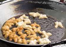 Frying mini Chinese Churros. Delicious Asia, Asian eating food. Frying mini Chinese Churros or Chinese Donut in a wok for breakfast menu. The Thai name is Stock Photography