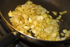 Frying onions Stock Photos