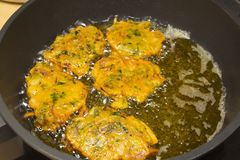Frying pakora snacks in a woke Stock Photography