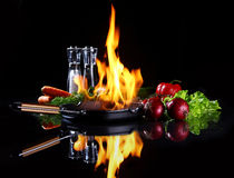 Frying pan with burning fire inside Royalty Free Stock Images