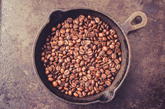Frying pan with coffee beans Royalty Free Stock Photography