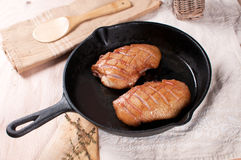 Frying pan with cooking duck breast Stock Photography