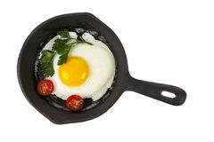 Frying pan with egg Stock Images
