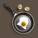 Frying pan with egg Stock Image