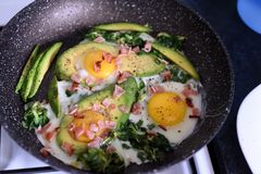Frying pan filled with vegetables and eggs stock photography