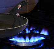 Frying pan into the fire Royalty Free Stock Images