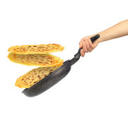 Frying pan with flying pancakes in women hand Stock Image
