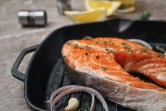 Frying pan with fresh raw salmon steak. Closeup Royalty Free Stock Image