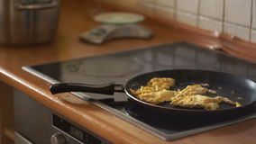 In the frying pan fried eggs. Useful breakfast, induction cooker, housewife. Kitchen, cooking, scrambled eggs. Close-up. stock footage