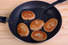 Frying pan with fritters Stock Photos