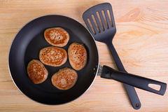 Frying pan with fritters Royalty Free Stock Photography