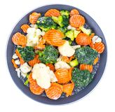 Frying pan with frozen vegetables. Studio Photo Stock Photos