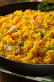 Frying pan full of rice on wood Stock Photography