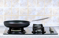 Frying pan on the gas stove stock photos