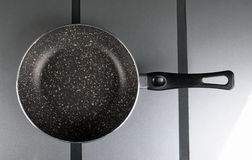 Frying pan on the glass substrate Royalty Free Stock Photos
