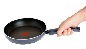 Frying pan in hand Stock Photo