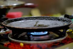 Frying pan heating. On gas stove close up royalty free stock photography