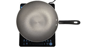 Frying pan on induction cooker Stock Photos
