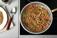 Frying pan with lentils. On electric stove Stock Image