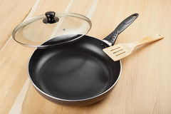 Frying pan with lid on table Stock Photography