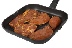 Frying pan with meat to the barbecue Royalty Free Stock Photo
