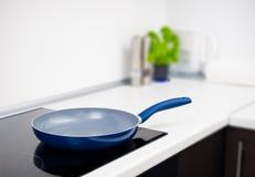 Frying pan in modern kitchen Stock Photos