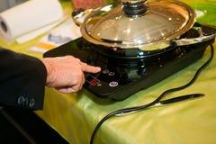 Frying pan in modern kitchen Royalty Free Stock Photo