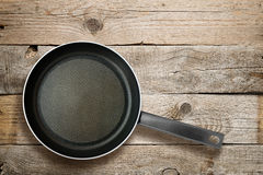 Frying pan on old wood Stock Photos