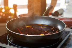 Frying pan with orange peel. Royalty Free Stock Photo