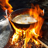 Frying Pan over Campfire Royalty Free Stock Images