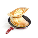 Frying pan and pancakes Stock Photos