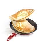 Frying pan and pancakes Stock Photos