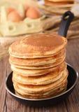 Frying pan with pancakes Stock Photos